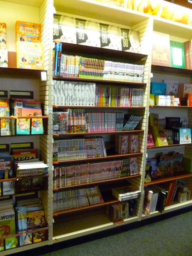 "This is the biggest rack of manga you can find in a Belgian shop. The picture is only a small part of a corner dedicated to ""graphic novels""."