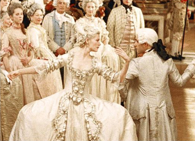 Kirsten Dunst demonstrates the wide pannier under a evening gown worn by Marie Antoinette.