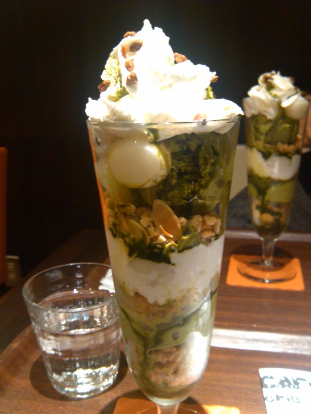 Matcha parfait with ice, cream, nuts, cookies, cornflakes, mochi and almonds